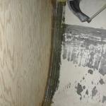 The fiberglass tabbing from the forward side of the bulkhead