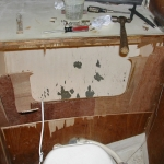 Removing the old structure behind thet toilet in the head