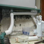 Fitting the discharge plumbing