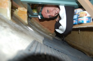 Emily working in one of the boat's lockers